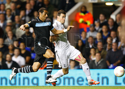 20.09.2012 London, ENGLAND: ..Gareth Bale of Tottenham Hotspur and Andre Dias of S.S. Lazio..in action during the Europa League Group J match between Tottenham Hotspur and SS Lazio at White Hart Lane Stadium......