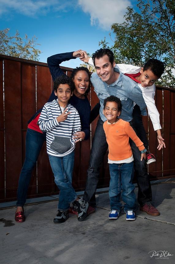 Kristina and Nicholas Krump and their boys, Jackson, 9 (stripes), Ellis, 7 (on Nicholas' back) and Evan, 5 (orange) at their Phoenix home.