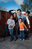 Kristina and Nicholas Krump and their boys, Jackson, 9 (stripes), Ellis, 7 (on Nicholas' back) and Evan, 5 (orange) at their Phoenix home.