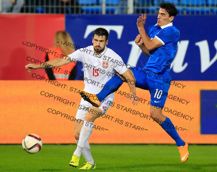 Fudbal<br /> Prijateljski mec-Friendly match<br /> Srbija v Grcka<br /> Nenad Tomovic (L) and Lazaros Christodoulopoulos<br /> Chania, 17.11.2014.<br /> foto: Srdjan Stevanovic/Starsportphoto &copy;