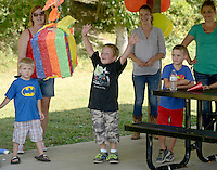 NWA Democrat-Gazette/BEN GOFF @NWABENGOFF<br /> Reese Miller (center) reacts after his friend broke open the piñata on Sunday Sept. 27, 2015 during his sixth birthday party at Lake Bella Vista in Bentonville.