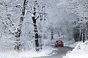 14/01/16<br /> <br /> Framed by snow covered trees a bright red mini drives slowly down Mam Tor in the Derbyshire Peak District near Edale. <br /> <br /> All Rights Reserved: F Stop Press Ltd. +44(0)1335 418365   +44 (0)7765 242650 www.fstoppress.com