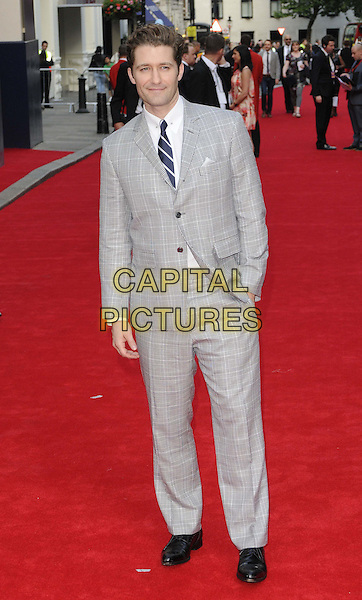 Matthew Morrison<br /> 'Charlie And The Chocolate Factory' press night, Theatre Royal, Drury Lane, London, England.<br /> 25th June 2013<br /> full length grey gray check suit hand in pocket<br /> CAP/CAN<br /> &copy;Can Nguyen/Capital Pictures