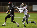 Lawndale, CA 09/29/17 - Jordan Wilmore (Lawndale #1) and Nathan Gottlieb (Torrance #18) in action during the Torrance vs Lawndale CIF Varsity football game at Lawndale High School.   Lawndale defeated Torrance 42-0.