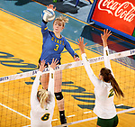 BROOKINGS, SD - OCTOBER 28: Makenzie Hennen #3 from South Dakota State gets the ball between the defense of Bella Lien #8 and Allie Mauch #2 from North Dakota State during their match Sunday afternoon at Frost Arena in Brookings. (Photo by Dave Eggen/Inertia)