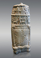 Stone Stele depicting  a ceremonial procession of Babylonian Gods. Circa 1186-1172 BC excavated from Susa where it had been taken as a spoil of war. Under the coils of the snake that wraps around the stele are represented the principal divinities of pantheon of Babylon as symbols. Below is a procession of two musicians and animals. Crenellated walls and towers surround the area reserve for an inscription that was never engraved. A horned serpent, emblem of the god Marduk, wraps around the base. Inv Sb 25. The Louvre Museum, Paris.