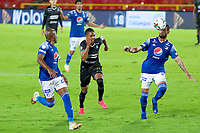 BOGOTA - COLOMBIA, 19-09-2020: Matias de los Santos y Felipe Banguero Millan de Millonarios disputan el balón con Alejandro Garcia de Once durante partido entre Millonarios y Once Caldas por la fecha 9 de la Liga BetPlay DIMAYOR 2020 jugado en el estadio Nemesio Camacho El Campin de la ciudad de Bogotá. / Matias de los Santos and Felipe Banguero Millan of Millonarios fights for the ball with Alejandro Garcia of Once during match between Millonarios and Once Caldas for the date 9 of the BetPlay DIMAYOR League 2020 played at the Nemesio Camacho El Campin Stadium in Bogota city. Photo: VizzorImage / Daniel Garzon / Cont.