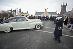 170318<br /> Tony Mulvey photographs Clare Association members from America during St Patricks Day parade in Ennis.Pic Arthur Ellis.