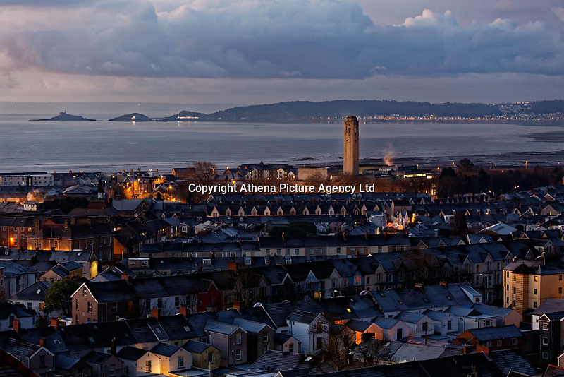 Ice on roof tops overlooking Mumbles during an early frosty morning in Swansea, Wales, UK. Tuesday 12 December 2017