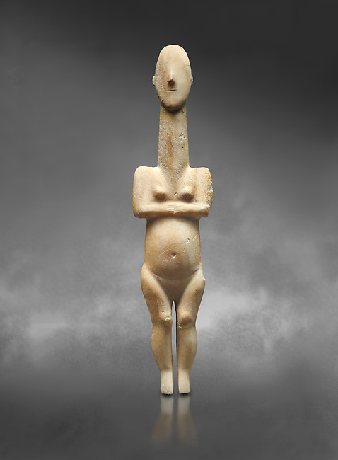 Cycladic statue figurine of the naturalistic 'Plastira' type of Paros from Glypha cemetery, grave 23, Cat no 4762. Early Cycladic Period I (Grotta-Pelos Phase 3200-2800 BC). National Archaeological Museum, Athens.   Gray background.<br /> <br /> <br /> This type of Cycladic figurine stand with feet lat to the ground with detailed facial features and ears to make a more realistic statue.