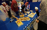 Palestinians take part in an exhibition of the Palestinian food, in Gaza city, on June  2, 2016. Photo by Mohammed Asad