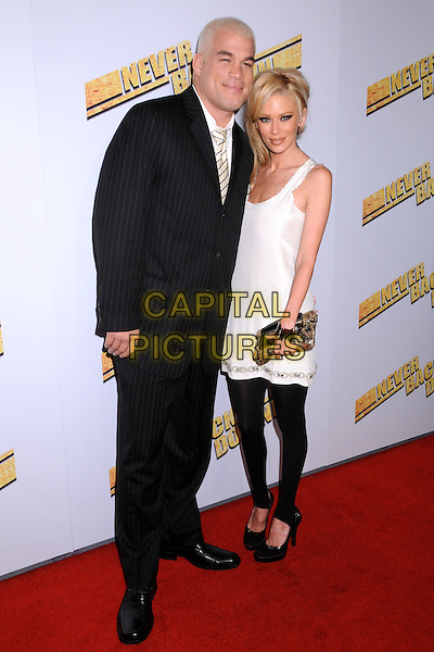 "TITO ORTIZ & JENNA JAMESON.""Never Back Down"" World Premiere at the Cinerama Dome, Hollywood, California, USA..March 4th, 2008.full length black suit white dress black leggings couple pinstripe clutch bag purse .CAP/ADM/BP.©Byron Purvis/AdMedia/Capital Pictures."