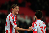 2nd December 2017, bet365 Stadium, Stoke-on-Trent, England; EPL Premier League football, Stoke City versus Swansea City; Ramadan Sobhi and Peter Crouch of Stoke City enjoy their victory at the end of the game