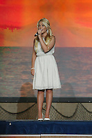 "4 April 2008: Country music recording artist Sarah Lenore sings, ""The Power of the Dream"" during Stanford's 2008 NCAA Division I Women's Basketball Final Four salute dinner at the Tampa Convention Center in Tampa Bay, FL."