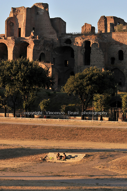 Rome, Italy: Palatine Hill with Roman ruins as seen from the Circus Maximus on a summer sunset.