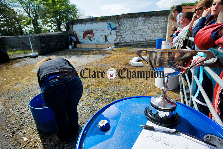 A competitor chooses her ammunition as the silverware awaits a winner at the World Stone Throwing Championships in Corofin. Photograph by John Kelly.