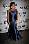 """Sara Ramirez (Grey's Anatomy and ATWT) wearing Angel Sanchez and David Meister and performing """"Buenos Aires"""" and """"How Could I Ever Know"""" at Broadway Takes the Runway which benefits Al D. Rodriguez Liver Foundation on October 4, 2010 at Touch, New York City, New York. (Photo by Sue Coflin/Max Photos)"""