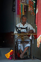 Tailor at the road side on the road from Varanasi India to Lumbini Nepal road scene in the rural area.