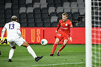 30th July 2020; Bankwest Stadium, Parramatta, New South Wales, Australia; A League Football, Adelaide United versus Perth Glory; Ben Halloran of Adelaide United watches his shot deflect off Osama Malik of Perth Glory and into the goal to make it 4-1 in the 45th minute