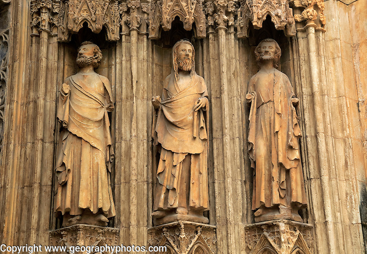 Statues of Christian saints carved stonework   of the cathedral church in city of Valencia, Spain