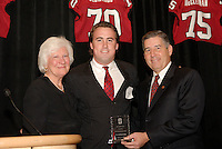 14 January 2007: Bob Bowlsby presents an award to T.C. Ostrander (Mary Gundelach is on the left) at the annual football banquet at McCaw Hall in Stanford, CA.