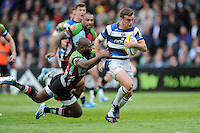 George Ford of Bath Rugby evades the tackle of Ugo Monye of Harlequins to score a try during the Aviva Premiership match between Harlequins and Bath Rugby at The Twickenham Stoop on Saturday 10th May 2014 (Photo by Rob Munro)