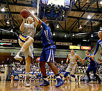 BROOKINGS, SD - NOVEMBER 18:  Mariah Clarin #40 from South Dakota State University is fouled while taking the ball to the basket by Brianna Rollerson #50 from Creighton in the first half of their game Tuesday night at Frost Arena in Brookings. (Photo by Dave Eggen/Inertia)
