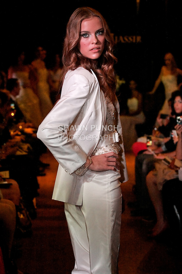 Model walks the runway in a Regal wedding outfit - classic silk taffeta tuxedo with beaded tulle blouse, by Sarah Jassir, for the Sarah Jassir Couture Bridal Fall 2012 Opulence collection.