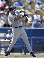 Mike Lowell of the Florida Marlins bats during a 2002 MLB season game against the Los Angeles Dodgers at Dodger Stadium, in Los Angeles, California. (Larry Goren/Four Seam Images)