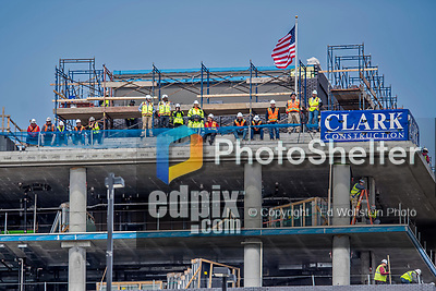 3 April 2017: Construction Workers from Clark Construction watch play from a rooftop as the Washington Nationals host the Miami Marlins on Opening Day at Nationals Park in Washington, DC. The Nationals defeated the Marlins 4-2 to open the 2017 MLB Season. Mandatory Credit: Ed Wolfstein Photo *** RAW (NEF) Image File Available ***