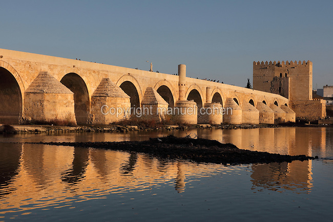 The Roman bridge, built 1st century BC over the Guadalquivir river, and the Torre de la Calahorra, a fortified city gate, built in the 12th century by the Almohads, in Cordoba, Andalusia, Southern Spain. The historic centre of Cordoba is listed as a UNESCO World Heritage Site. Picture by Manuel Cohen