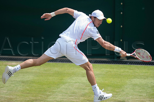 29.06.2012  The All England Lawn Tennis and Croquet Club. London, England. Juan Monaco of Argentina in action against Viktor Troicki of Serbia during third round at Wimbledon Tennis Championships at The All England Lawn Tennis and Croquet Club. London, England, UK