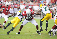 Aug. 28, 2009; Glendale, AZ, USA; Arizona Cardinals tight end (89) Ben Patrick blocks Green Bay Packers cornerback (39) Trevor Ford and safety (29) Anthony Smith during a preseason game at University of Phoenix Stadium. Mandatory Credit: Mark J. Rebilas-