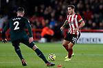 Billy Sharp (r) of Sheffield United runs at Ciaran Clark of Newcastle United during the Premier League match at Bramall Lane, Sheffield. Picture date: 5th December 2019. Picture credit should read: James Wilson/Sportimage