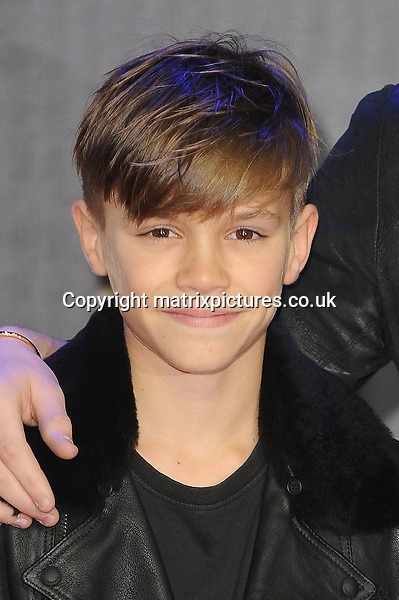 NON EXCLUSIVE PICTURE: PAUL TREADWAY / MATRIXPICTURES.CO.UK<br /> PLEASE CREDIT ALL USES<br /> <br /> WORLD RIGHTS<br /> <br /> Romeo Beckham, son of English footballer David Beckham attending the European Premiere of Star Wars: The Force Awakens in Leicester Square, in London.<br /> <br /> DECEMBER 16th 2015<br /> <br /> REF: PTY 153700