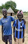 ETHIOPIA, Gambela, region Itang, Nuer village Pilual, boy Bhan 12 years old / AETHIOPIEN, Gambela, Region Itang, Dorf Pilual der Ethnie NUER, Hof von Herr Mun Kunen und Frau Neelam , sie sind vor dem Buergerkrieg aus dem Suedudan gefluechtet, Junge Bhan 12 Jahre und sein Freund Yop