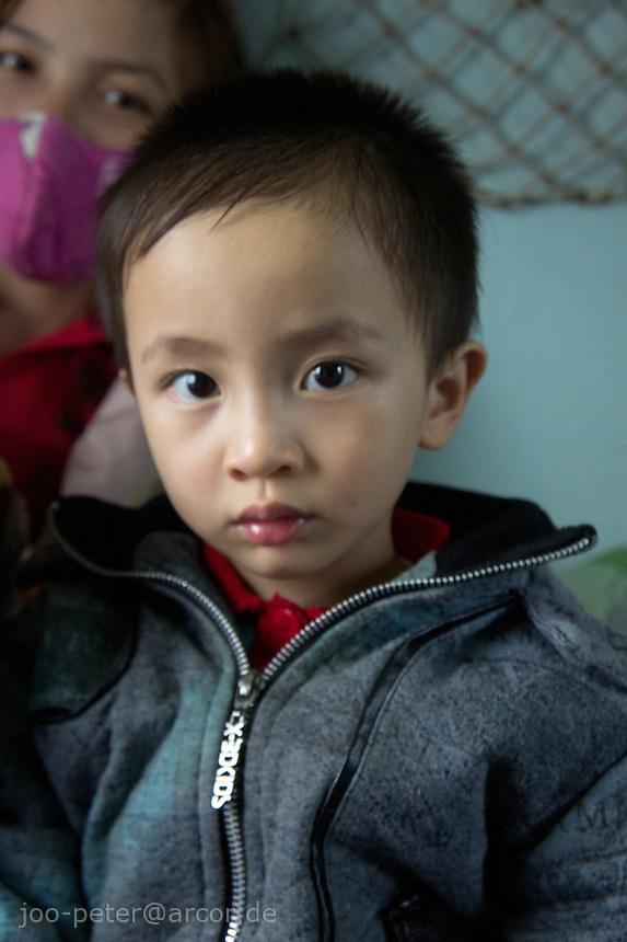 boy on the train in Vietnam