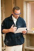 Plastering student reading his next task, Able Skills, Dartford, Kent.