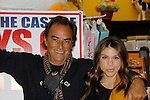 """Cast of Days Of Our Lives - Thaao Penghlis """"Andre DiMera"""",  Kate Mansi """"Abigail Devereaux"""" sign book """"Days Of Our Lives 50 Years"""" by Greg Meng - author & co-executive producer on October 27, 2015 at Books & Greetings, Northvale, New Jersey. (Photo by Sue Coflin/Max Photos)"""