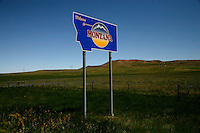"A sign that says ""Welcome to Montana"" stands at the border between Montana and South Dakota."