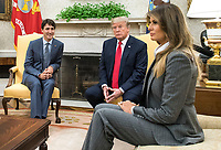 United States President Donald Trump (2nd-R) and first lady Melania Trump (R) meet with Canadian Prime Minister Justin Trudeau (L) and his wife Sophie Gr&Egrave;goire (not pictured) in the Oval Office at the White House in Washington, D.C. on October 11, 2017. <br /> Credit: Kevin Dietsch / Pool via CNP /MediaPunch<br /> CAP/MPI/RS<br /> &copy;RS/MPI/Capital Pictures