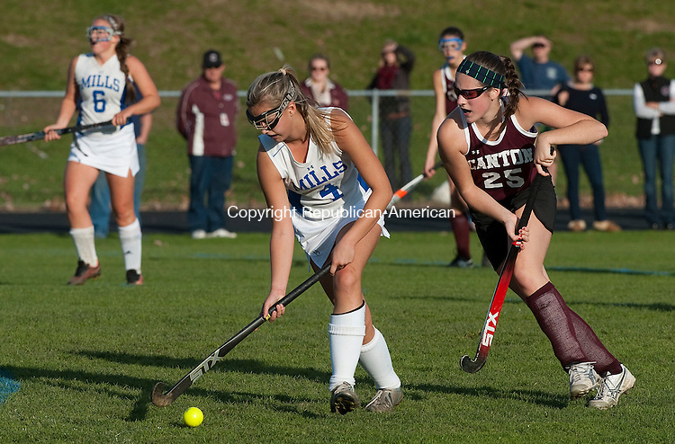 BURLINGTON, CT-110414JS12-  Lewis Mills' Julia Arel (4) pushes the ball past Canton's Jenna Dimartino (25) during their Class S tournament game Tuesday at Lewis Mills High School in Burlington.<br /> Jim Shannon Republican-American
