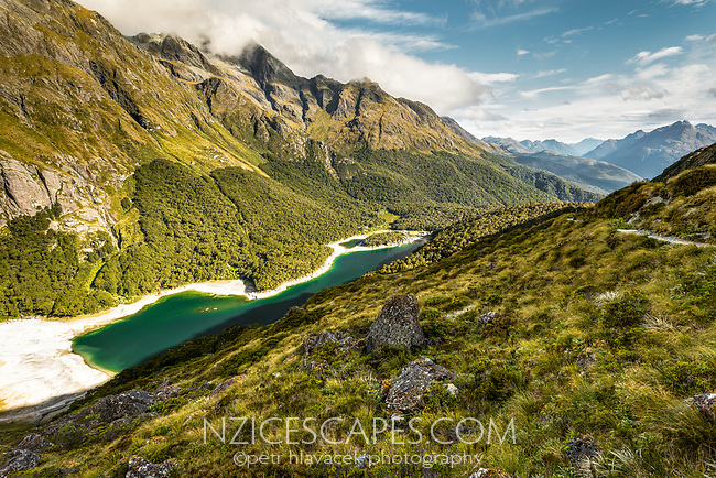 Emerald green Lake Mackenzie on Routeburn Track under Ailsa Mountains, Fiordland National Park, Southland, South Island, UNESCO World Heritage Area, New Zealand, NZ