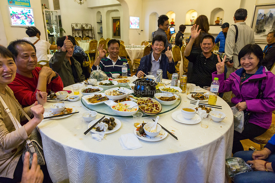 Guilin, China.  Chinese Friends at Dinner in a Restaurant.