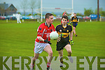 Rathmore's Brendan Reen is chased by Dr Crokes Jamie Doolan during their East Kerry Under 21 championship final in Rathbeg, Rathmore on Saturday.....