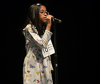 NWA Democrat-Gazette/ANDY SHUPE<br /> Second-place finisher Mirelle Rahman, a student at Holcomb Elementary School in Fayetteville, spells a word Saturday, Jan. 12, 2019, while competing in the Washington County Spelling Bee at the Farmington Performing Arts Center.