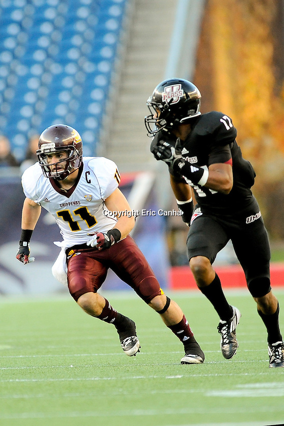Central Michigan Chippewas wide receiver Cody Wilson (11) is covered by Massachusetts Minutemen defensive back Randall Jette (17) during the Central Michigan Chippewas vs Massachusetts Minutemen NCAA football game held at Gillette Stadium in Foxborough, Massachusetts.  Eric Canha/CSM