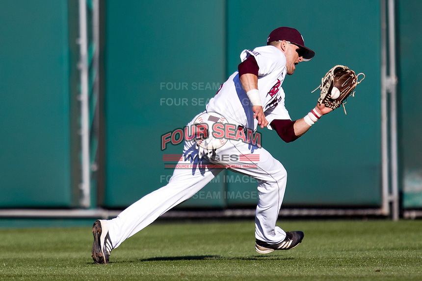 Spiker Helms (9) of the Missouri State Bears catches a ball in center field during a game against the Southern Illinois University- Edwardsville Cougars at Hammons Field on March 9, 2012 in Springfield, Missouri. (David Welker / Four Seam Images).