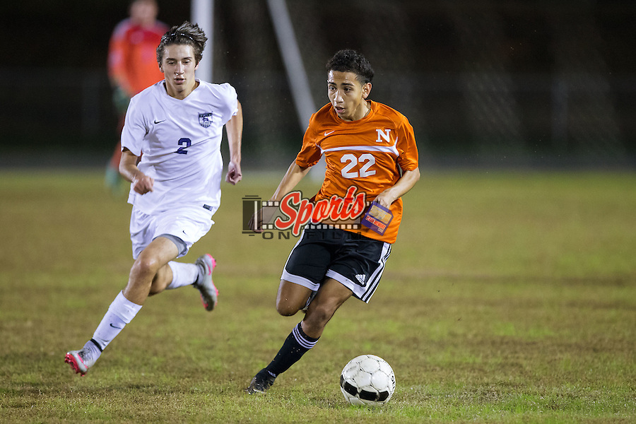 Brandon Esparza (22) of the Northwest Cabarrus Trojans controls the ball during first half action against the Cox Mill Chargers at Cox Mill High School on November 4, 2015 in Concord, North Carolina.  The Chargers defeated the Trojans 6-1 in the first round of the 2015 NCSHAA 3A playoffs.  (Brian Westerholt/Sports On Film)