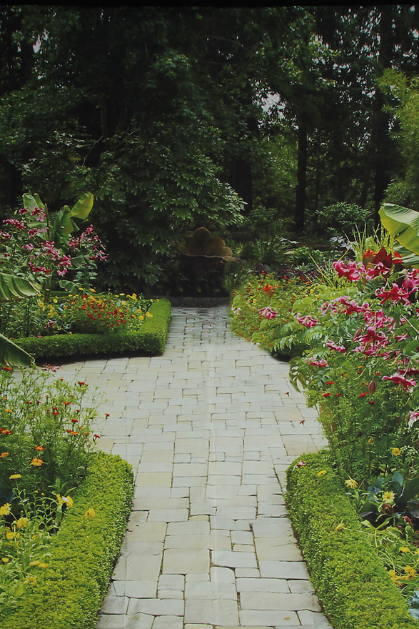 Backdrop featuring a garden patio walkway with flowers and trees surrounding